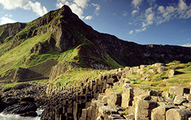 A view of the dramatic coastline at the Giant's Causeway, County Antim, Northern Ireland, taken in the sunshine with rocks visible in the foreground