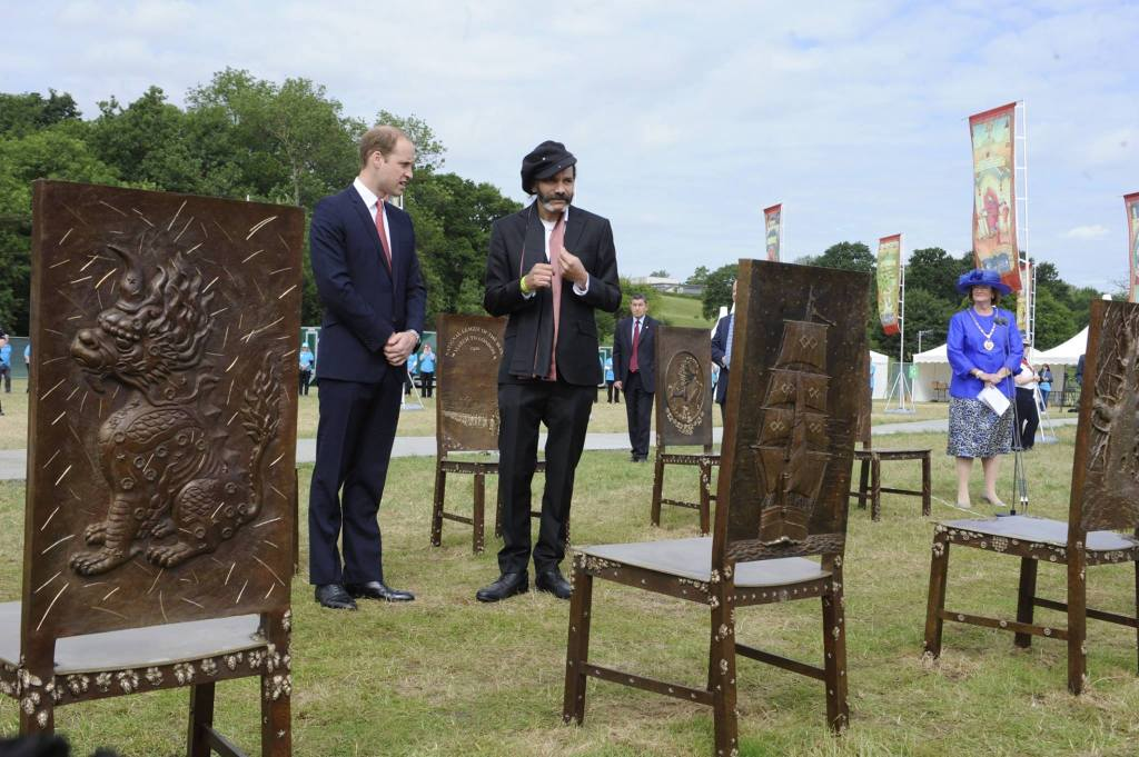 The Duke of Cambridge meets artist Hew Locke, creator of a new permanent artwork at Runnymede. 'The Jurors' is formed of 12 bronze chairs, each decorated with images and symbols relating to past and ongoing struggles for freedom, the rule of law and equal rights.