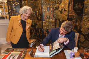 Royal Oak lecturer Jeremy Musson signs a copy of his book for Kathleen Buoymaster following his lecture in La Jolla, California