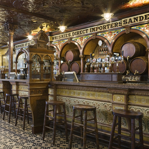 A view inside The Crown Bar, Great Victoria Street, Belfast. Formerly known as the Crown Liquor Saloon, the pub building dates from 1826 but the wonderful late Victorian craftsmanship of the tiling, glass and woodwork undertaken by Italian workers dates from 1898.