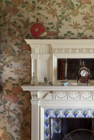 Detail of a fireplace and mantlepiece at Wightwick Manor and Gardens, West Midlands.