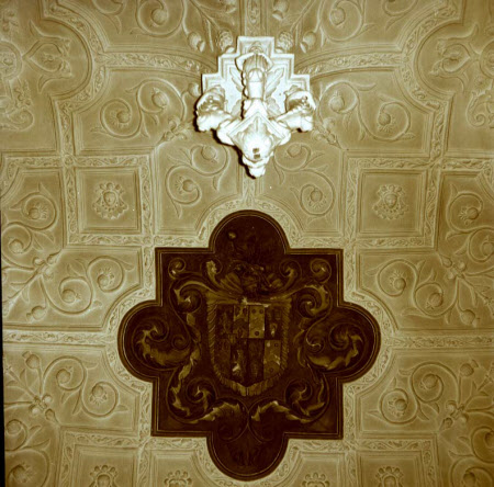 Canons Ashby Drawing Room ceiling, close view to pendant boss and painted coat-of-arms. National Trust Images