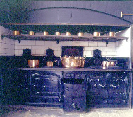 The Kitchen, view of the range with copper pans