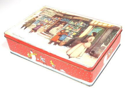 Part of a cake decorating and icing kit; Part of a rectangular biscuit tin; Base section with festive design 'Christmas Shoppers'.