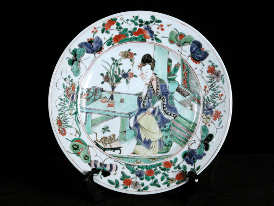 Chinese porcelain plate decorated with a lady seated at a table, her head resting in her hand, c. 1690-1720, collection of Captain George Francis Warre, given to the National Trust by Mrs. George Warre, 1961, at Dudmaston, NT 813530. ©National Trust/Claire Reeves
