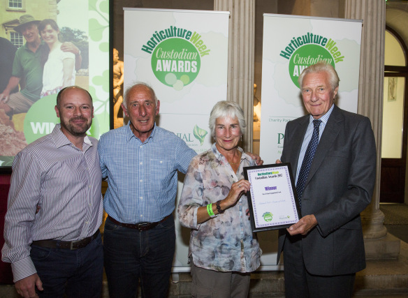 The team from Croome accepting their award from Lord Heseltine (C) Horticulture Week