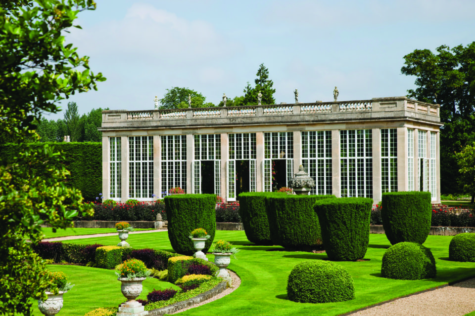 The Orangery and Italian Garden in July at Belton House, Lincolnshire. The Orangery was designed by Wyatville and built in 1819.