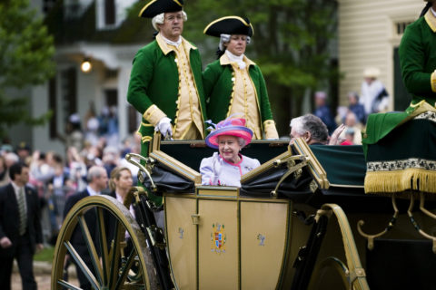 Queen Elizabeth II waving to crowds on a carriage ride in Colonial Williamsburg, 2007