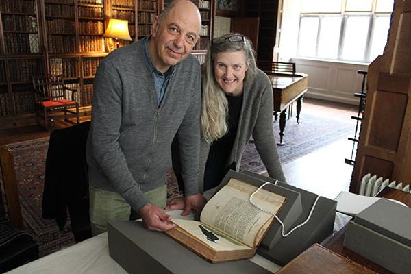 Artists Neville and Joan Gabie with Blickling Estate's copy of De Avium Natura. © National Trust / Jennifer Watson
