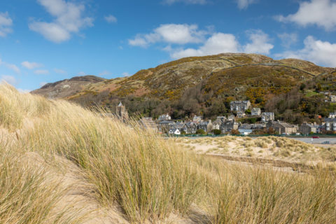 View of Dinas Oleu headland from Barmouth beach- National Trust